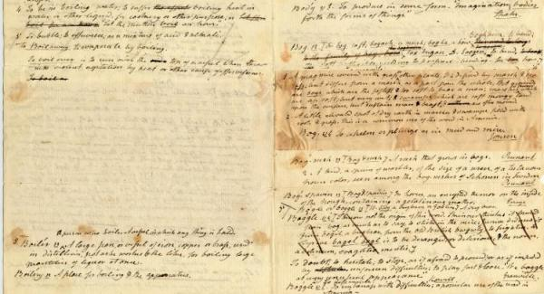 The image shows a handwritten page with crossing-out, insertions, a section pasted over another and a whole paragraph diagonally crossed out.  The paper is old and yellowing. It is actually a page from the original manuscript for the first Webster's dictionary.